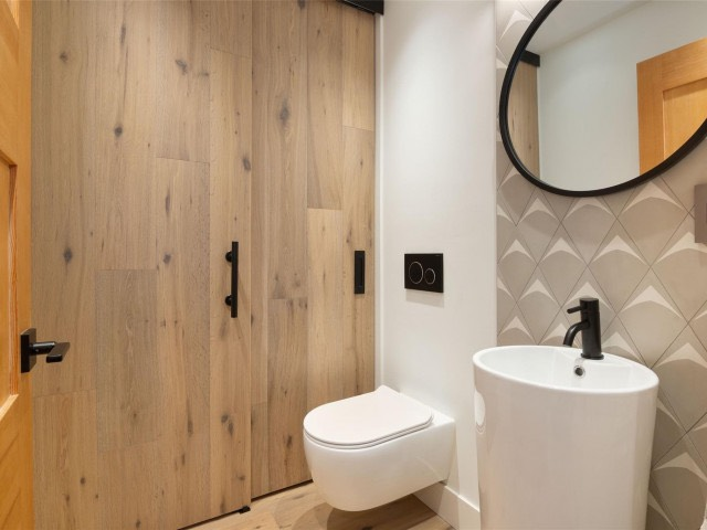 renovated bathroom by lee carter plumbing with wood finishes