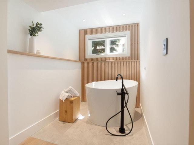 renovated bathroom by lee carter plumbing with soaker tub