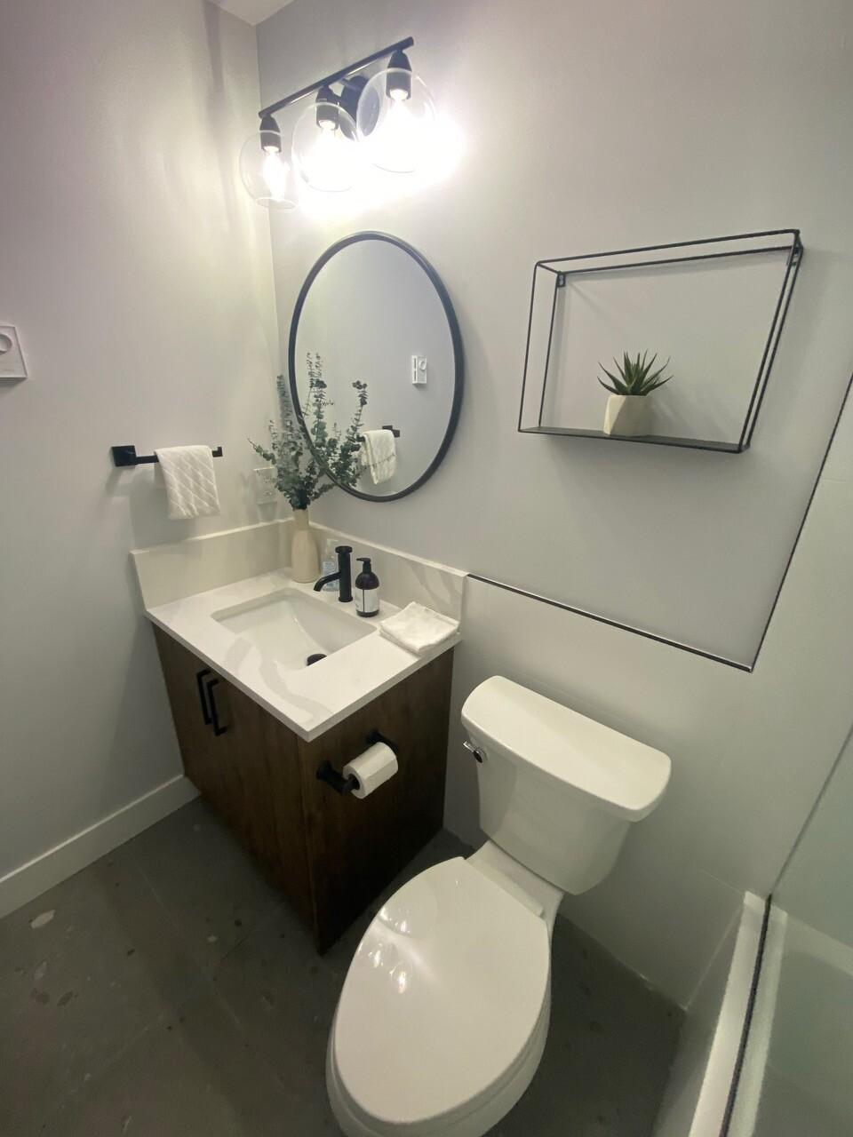 dark colour scheme renovated bathroom by lee carter plumbing
